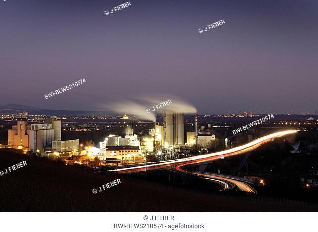 illuminated cement mill in the city, Germany, Rhineland-Palatinate, Mainz-Laubenheim