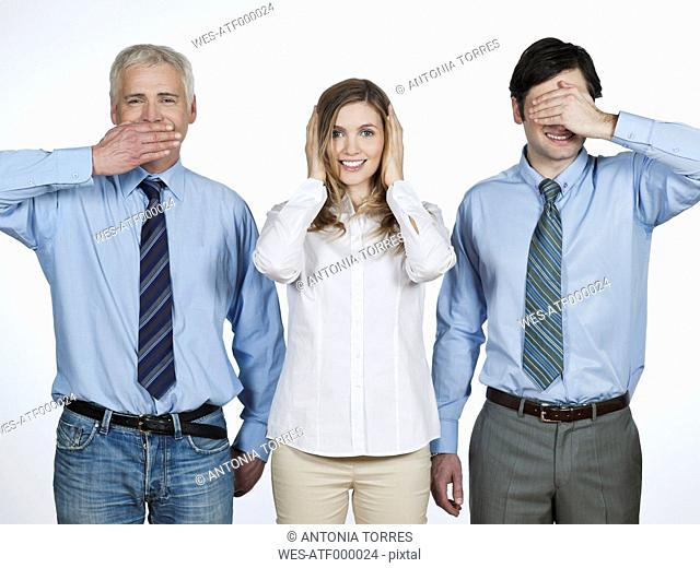 Men and woman doing see no evil, hear no evil, speak no evil