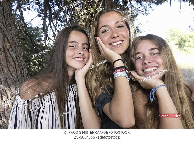 Three beautiful girls posing in the garden, Valencia, Spain