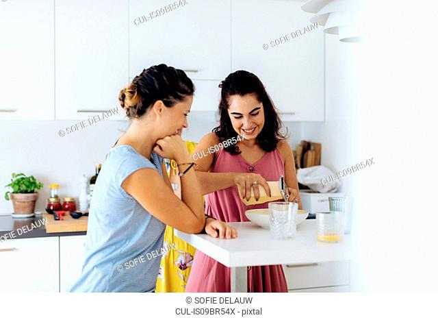 Friends preparing lunch in kitchen