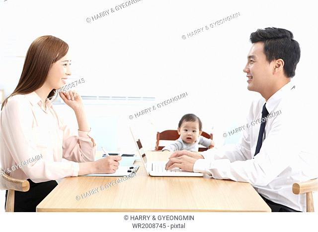 business couple looking after a baby