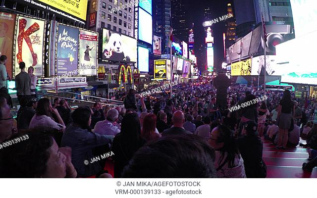 New York City, USA - 19 May 2015: Crowded bleacher seats and Times Square at night in Midtown Manhattan