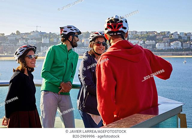 Group of tourists and guide making a bicycle tour through the city, La Concha Bay, Donostia, San Sebastian, Gipuzkoa, Basque Country, Spain, Europe