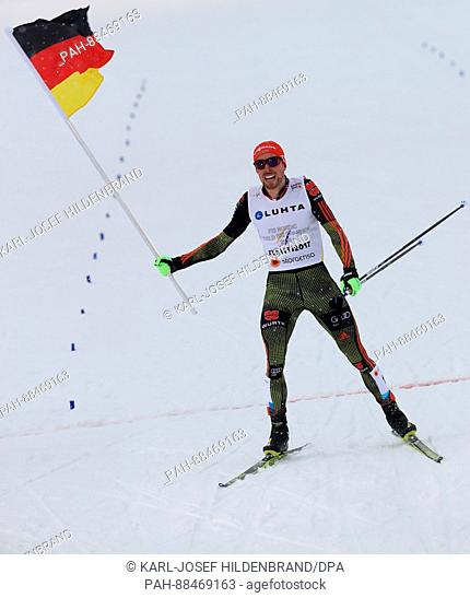 Johannes Rydzek from Germany celebrates after the men's team combination normal hill/4x5 km event at the Nordic World Ski Championships in Lahti, Finland