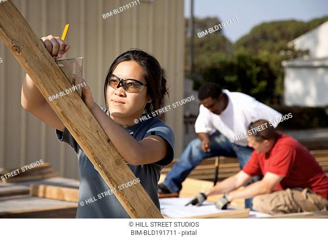 Asian woman working at construction site