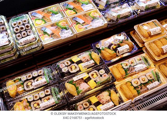 Packaged sushi rolls, prepared food on display in a Japanese supermarket. Tokyo, Japan