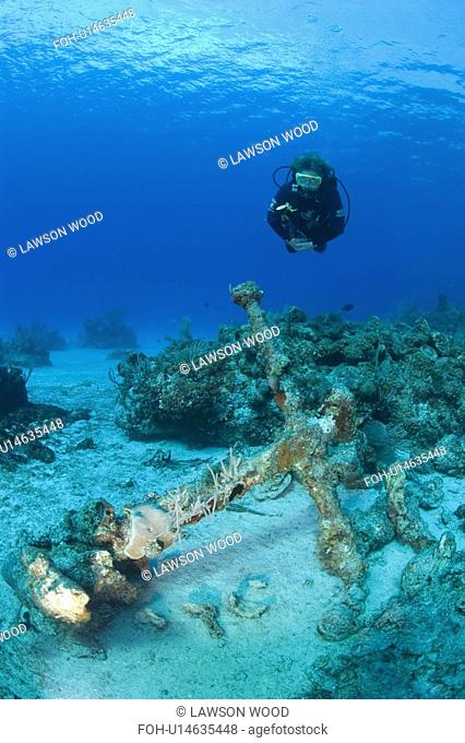 Diver over unidentified ship's anchor, Maria La Gorda, Cuba, Caribbean