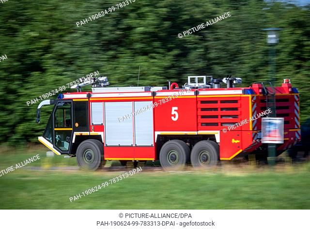 24 June 2019, Mecklenburg-Western Pomerania, Jabel: A special Bundeswehr airport fire engine drives to the crash site near Jabel