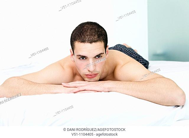 Portrait of a man lying in bed
