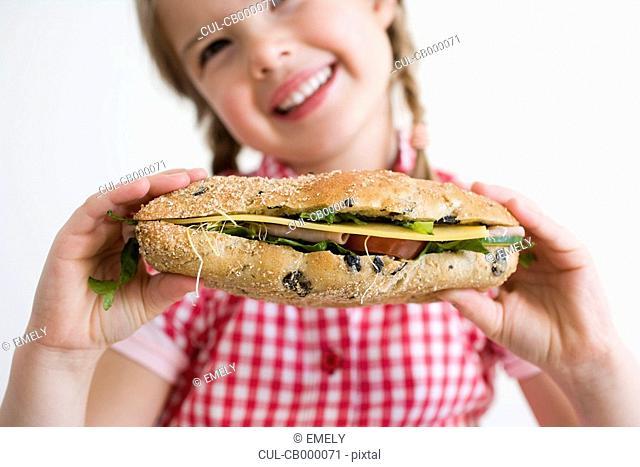 Girl holding sandwich
