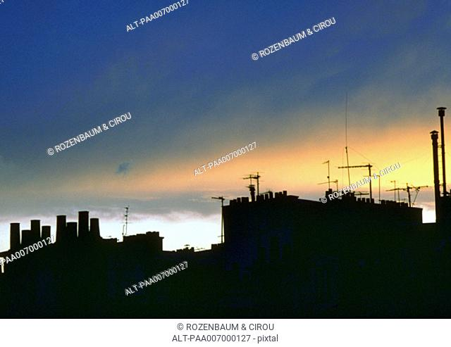 France, Paris, rooftops silhouetted at twilight