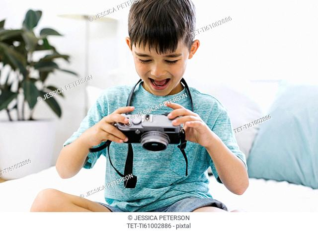Boy (8-9) watching camera with curiosity