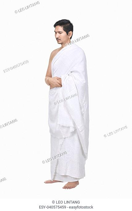 Religious asian muslim man with hajj dress isolated over white background