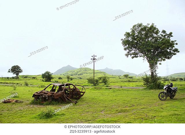 Adandoned rusted car in the field, Maharashtra, India