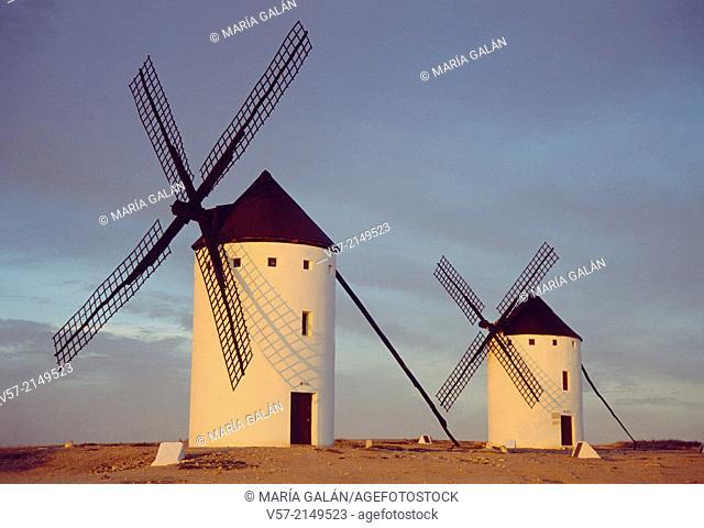 Two windmills at dusk. Campo de Criptana, Ciudad Real province, Castilla La Mancha, Spain