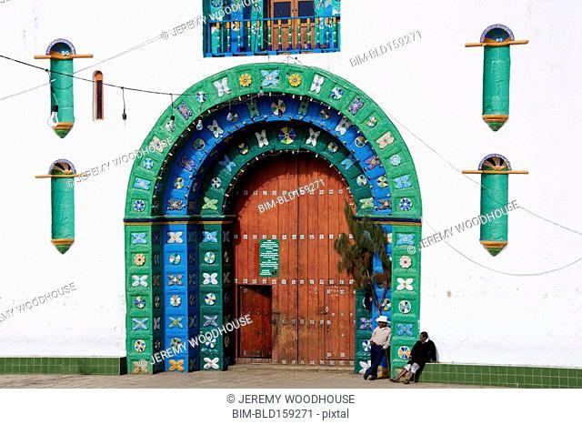 People standing outside church door, San Juan Chamula, Chiapas, Mexico