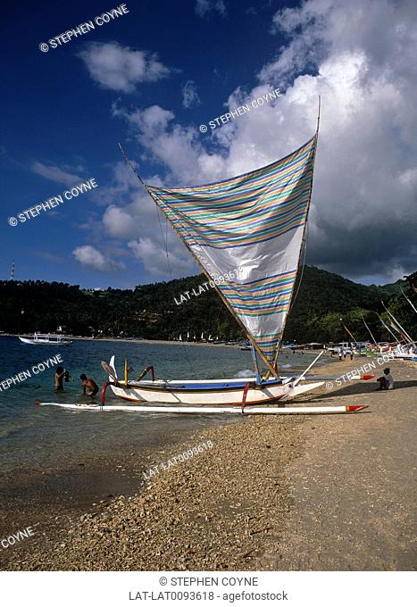The local boats in Bali are outrigger dug out canoes with small masts and a rudimentary sail and rudder. They are often brightly painted