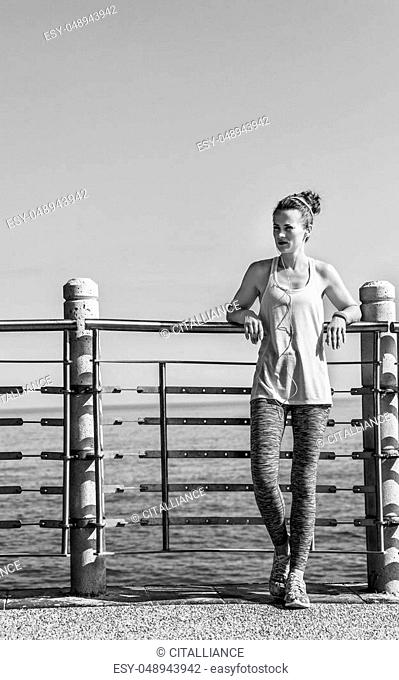 Look Good, Feel great! Full length portrait of young woman in fitness outfit looking into the distance at the embankment