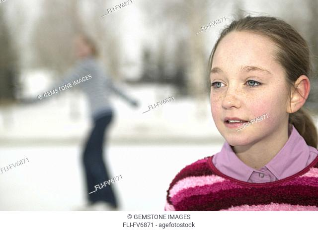 FV6871, Scott Dimond, Girl with another Skater in Background at Outdoor Skating Rink