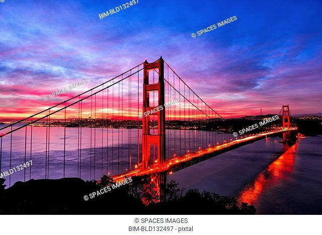 Golden Gate Bridge lit up at sunset, San Francisco, California, United States