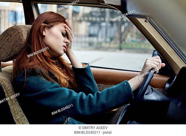 Frustrated Caucasian woman driving car