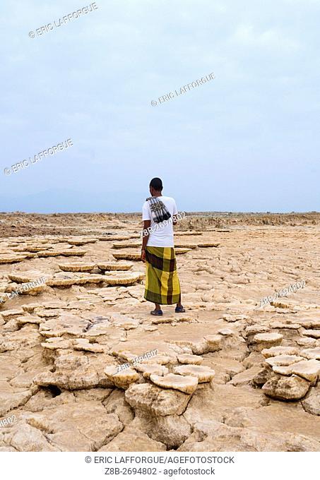 Ethiopia, Afar Region, Dallol, afar man in the volcanic formations of the danakil depression