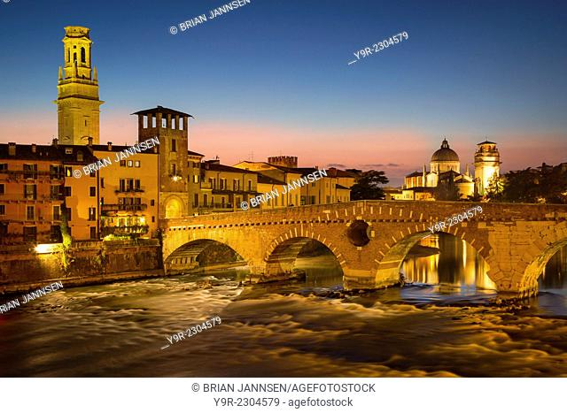 Ponte Pietra over River Adige with Cathedral Anastasia and the skyline of Verona beyond, Veneto, Italy