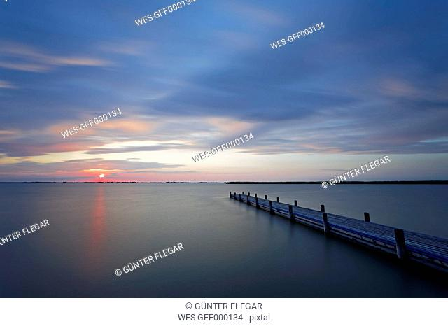 Austria,Burgenland, View of dock on Lake Neusiedl at sunrise