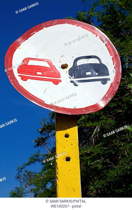 Weathered 'no overtaking' road sign near Trinidad, Cuba