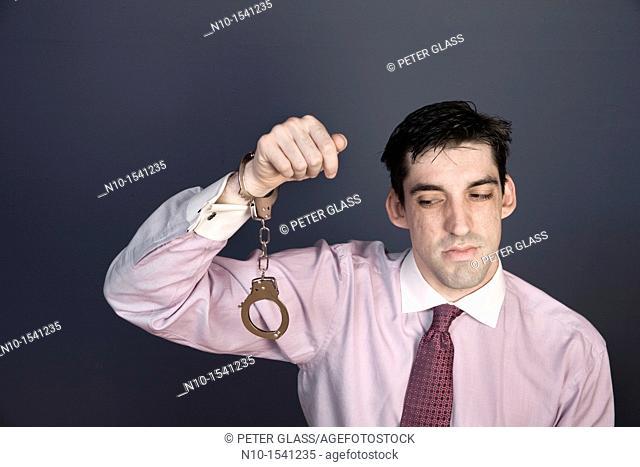 Man wearing handcuffs on one wrist