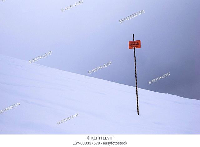 Boundary sign in the snow