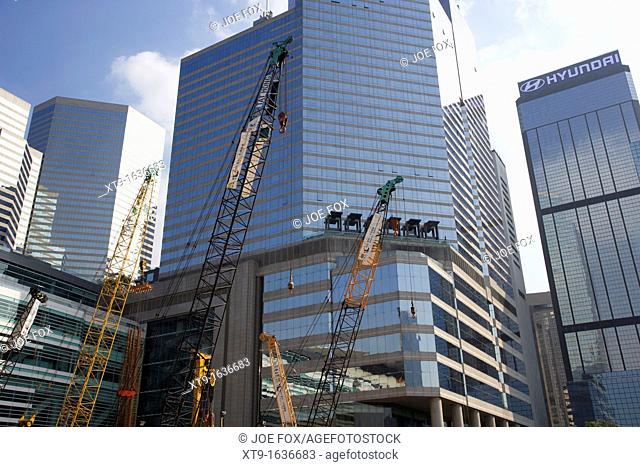 construction cranes against modern office buildings in wan chai hong kong hksar china asia
