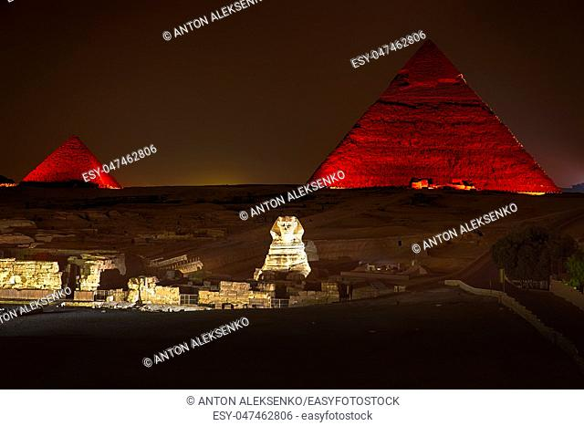 Night view on the enlighted Pyramids of Giza, Egypt