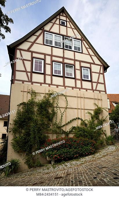Half-timbered house built on a sloped lot in the town of Bad Wimpfen, Germany