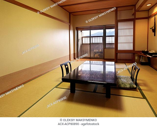 Traditional Japanese room at a ryokan with Mount Fuji view in the window. Fujikawaguchiko, Yamanashi, Japan