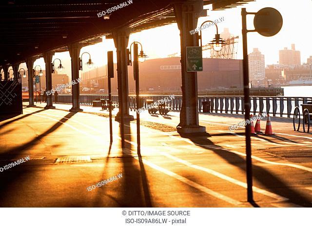 Cycle and walkway below bridge at sunset New York City, USA