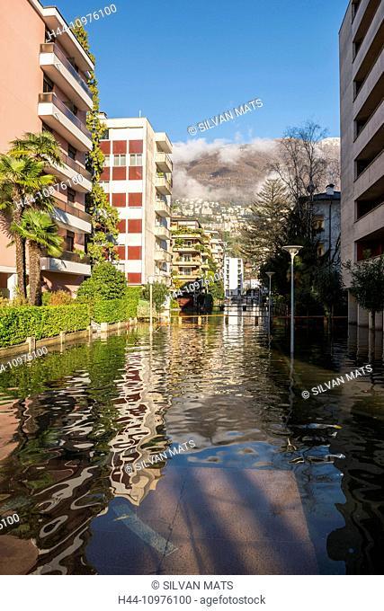 Alpine lake Maggiore flooding Locarno city in a sunny day in Ticino, Switzerland