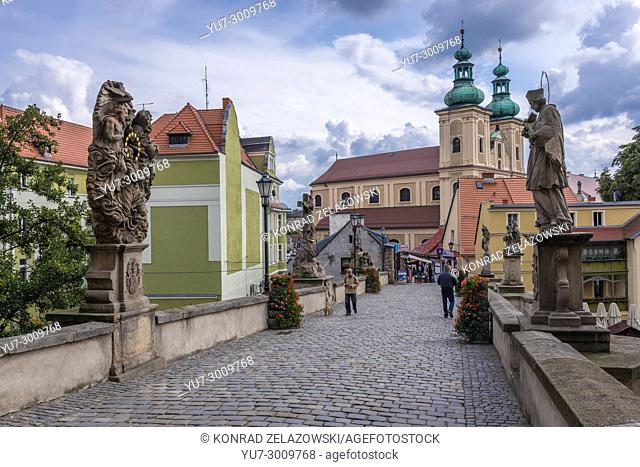 View on Church of Our Lady of the Rosary from Gothic bridge of Saint John over Mlynowka River in Klodzko town, Lower Silesian Voivodeship of Poland