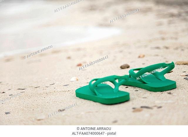 Sandals left on beach