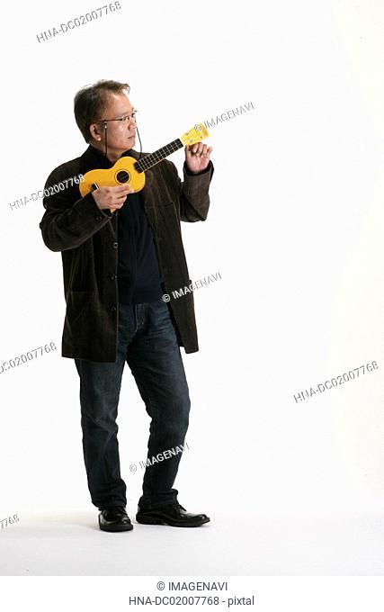 A man playing the ukulele