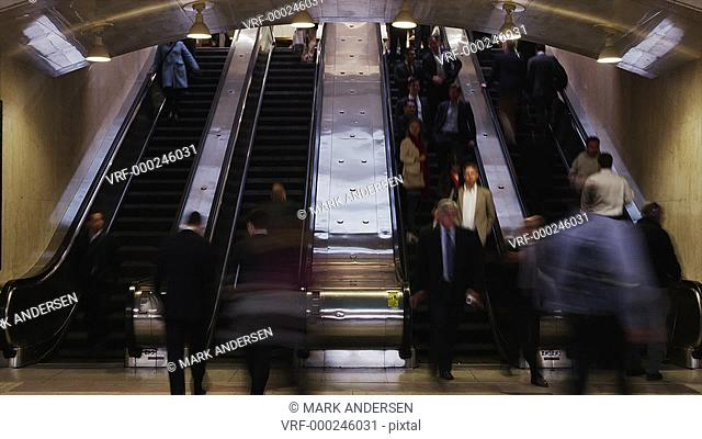 Time lapse wide shot of people on escalators at Grand Central Station / New York City, New York, United States