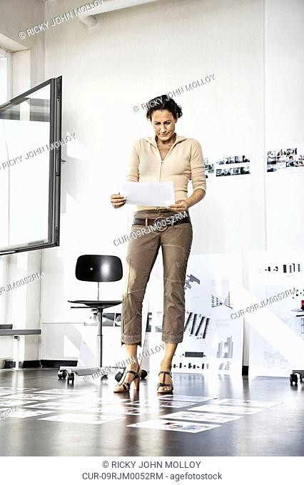 Woman in architect office, working