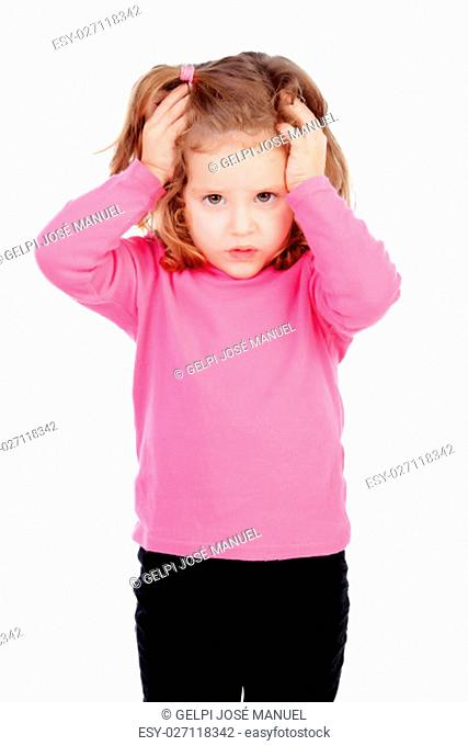 Worried little girl in pink isolated on a white background