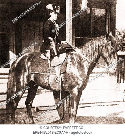 Belle Starr 1848-1889 on a horse. She rode in side saddle, and dressed in velvet, with feathered hats. Gene Tierney starred in the 1941 film, BELLE STARR