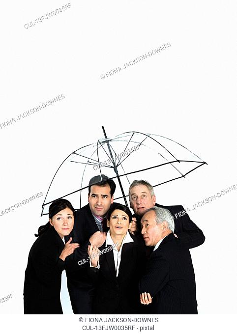 A business group under a clear umbrella