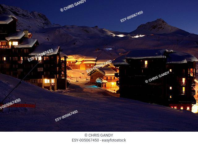 Dusk over a snowy alpine scene