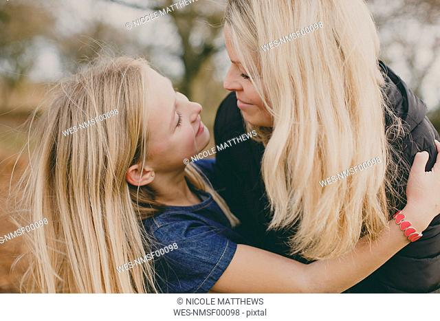Mother and daughter smiling at each other