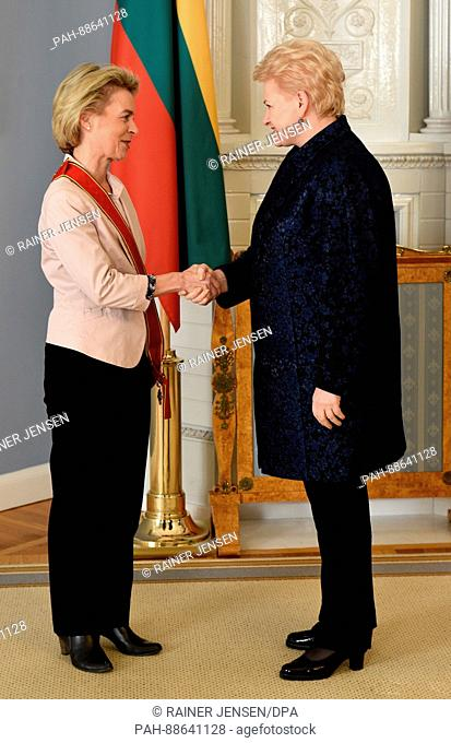 German defence minister Ursula von der Leyen (L) receives the Grand Cross of Order for Merits to Lithuania from the Lithuanian president Dalia Grybauskaite in...
