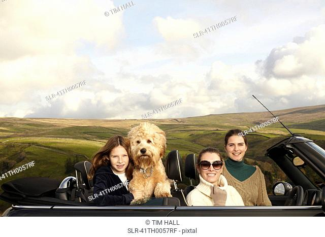 Family driving in rural landscape