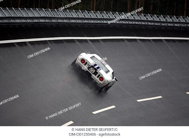 Ford GT, model year 2005-, white-blue moving, diagonal from the back, rear view, test track